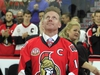 Former Ottawa Senators player Daniel Alfredsson watches as a banner with his retired jersey number 11, is raised to the rafters in Ottawa, Thursday December 29, 2016. THE CANADIAN PRESS/Fred Chartrand ORG XMIT: FXC117