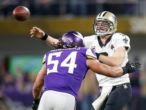 Drew Brees of the New Orleans Saints throws a pass under pressure from Eric Kendricks of the Minnesota Vikings during the NFC Divisional Playoff game at U.S. Bank Stadium on January 14, 2018 in Minneapolis. (Jamie Squire/Getty Images)