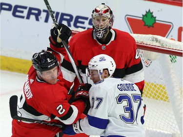 Tampa Bay centre Yanni Gourde (37) tangles with Ottawa defenceman Dion Phaneuf (2) in front of goaltender Craig Anderson in the thired period of play at Canadian Tire Centre.