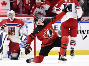 Drake Batherson celebrates after scoring one of his three goals for Canada in Thursday's semifinal win against the Czech Republic in the world junior championship at Buffalo.