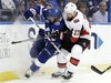Ottawa Senators center Nate Thompson (17) checks Tampa Bay Lightning left wing Chris Kunitz (14) into the boards as they chase a loose puck during the first period of an NHL hockey game Thursday, Dec. 21, 2017, in Tampa, Fla. (AP Photo/Chris O'Meara) ORG XMIT: TPA104