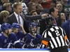 Tampa Bay Lightning coach Jon Cooper argues with official Mike Hasenfratz (2) about a late line change during the first period of the team's NHL hockey game agains the Minnesota Wild on Saturday, Dec. 23, 2017, in Tampa, Fla. (AP Photo/Chris O'Meara) ORG XMIT: TPA105