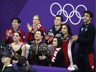 """Canada's Tessa Virtue and Scott Moir wait in the """"kiss and cry"""" area after competing during the figure skating ice dance team event on Sunday. Leah Hennel/Postmedia"""