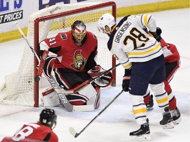 The Buffalo Sabres' Zemgus Girgensons watches as the puck passes the goal post of Ottawa Senators goaltender Craig Anderson in the second period.