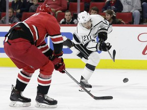 Nick Shore shoots the puck at the Hurricanes' net during the Kings' game at Raleigh on Tuesday night. Shore completed the game with L.A. and then became property of the Senators following the trade with Marian Gaborik for Dion Phaneuf and Nate Thompson.