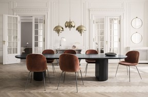 A pair of Randaccio circular wall mirrors in a vintage brass finish, and a trio of Multi-Lite Pendant lamps designed by Louis Weisdorf, add a brassy touch of bling to this room dominated by Celadon's Moon dining table, part of the Gubi collection.