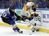 St. Louis Blues' Oskar Sundqvist, of Sweden, left, and Nashville Predators' Kyle Turris, right, chase after a loose puck during the first period of an NHL hockey game Friday, Nov. 24, 2017, in St. Louis. (AP Photo/Jeff Roberson) ORG XMIT: MOJR101