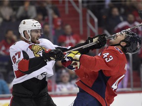 Defenceman Ben Harpur (67) gets his stick up on the Capitals' Tom Wilson (43) in a Nov. 22 game, during one of his previous NHL callups by the Senators.
