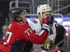Washington Capitals right wing T.J. Oshie (77) and Ottawa Senators left wing Zack Smith (15) crash into the boards during the third period of an NHL hockey game Tuesday, Feb. 27, 2018, in Washington. The Capitals won 3-2. (AP Photo/Pablo Martinez Monsivais) ORG XMIT: VZN109