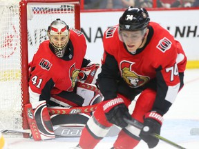 Craig Anderson and Mark Borowiecki (R) of the Ottawa Senators in action against the Buffalo Sabres during second period of NHL action at Canadian Tire Centre in Ottawa, March 08, 2018.