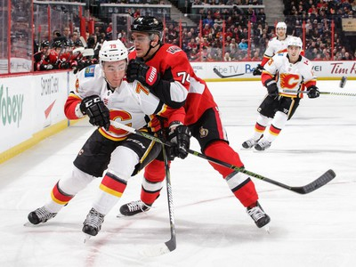 Mark Borowiecki (74) of the Senators battles for position against Micheal Ferland of the Flames in the first period.