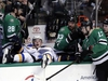 St. Louis Blues defenseman Vince Dunn (29) lands in the Dallas Stars bench after attempting to glove an airborne puck as the Stars' Stephen Johns (28), Marc Methot (33), Devin Shore (17) and Esa Lindell of Finland, right, watch in the third period of an NHL hockey game Saturday, March 3, 2018, in Dallas. (AP Photo/Tony Gutierrez) ORG XMIT: DNA110