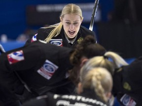 Russia skip Victoria Moiseeva calls for the sweep on one of her shots as they play the United States during the bronze medal game at the World Women's Curling Championship Sunday, March 25, 2018 in North Bay, Ont.