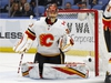 The puck gets past Calgary Flames goalie David Rittich (33) for the only Buffalo Sabres goal during the third period of an NHL hockey game, Wednesday, March. 7, 2018, in Buffalo, N.Y. (AP Photo/Jeffrey T. Barnes) ORG XMIT: NYJB114