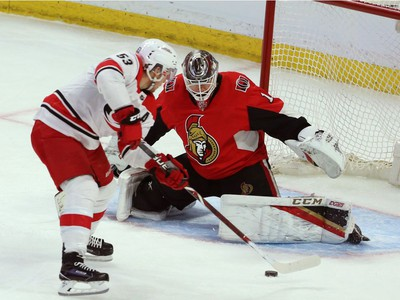 Hurricanes centre Jeff Skinner prepares to backhand the puck past Senators netminder Mike Condon for a third-period goal.