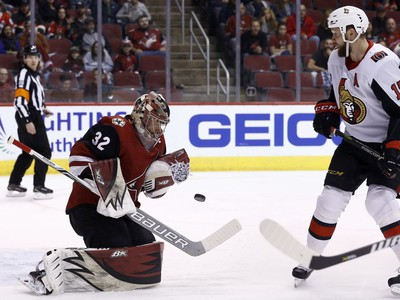 Arizona Coyotes goaltender Antti Raanta makes a save on a shot as Ottawa Senators left-winger Zack Smith looks on during the first period.