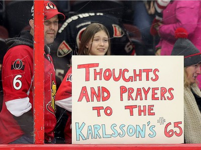 At least one youngster was feeling for defenceman Erik Karlsson and his wife Melinda who loss their baby as the Ottawa Senators take on the Florida Panthers in NHL action at the Canadian Tire Centre in Ottawa.  Photo by Wayne Cuddington/ Postmedia
