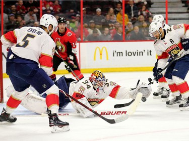 James Reimer pounces on the loose puck in the first period as the Ottawa Senators take on the Florida Panthers in NHL action at the Canadian Tire Centre in Ottawa.  Photo by Wayne Cuddington/ Postmedia
