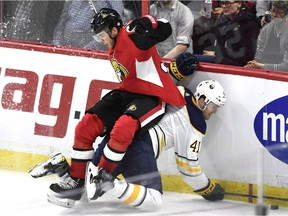 Senators winger Magnus Paajarvi, top, and the Sabres' Justin Falk crash into the boards during the second period of a game in Ottawa in March.