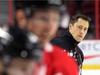 Head coach Guy Boucher watches the players during the Ottawa Senators practice at the Canadian Tire Centre in Ottawa. Photo by Wayne Cuddington/ Postmedia