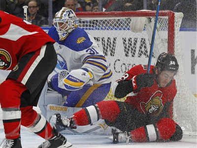 Buffalo Sabres goalie Chad Johnson (31) looks for the puck as Ottawa Senators forward Mike Hoffman (68) collides with the goal during the second period of an NHL hockey game Wednesday, April 4, 2018, in Buffalo, N.Y.