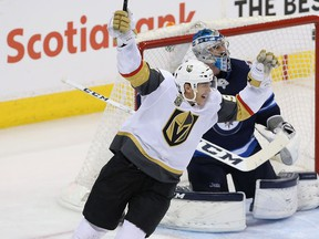 Tomas Nosek #92 of the Vegas Golden Knights celebrates a second period goal by Ryan Reaves #75 (not pictured) against the Winnipeg Jets in Game Five of the Western Conference Finals during the 2018 NHL Stanley Cup Playoffs at Bell MTS Place on May 20, 2018 in Winnipeg.