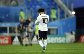 Egypt's Mohamed Salah leaves the pitch after Tuesday's loss to Russia. (AP PHOTO)