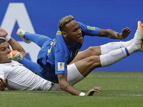 Brazil's Neymar is brought down by Costa Rica's Cristian Gamboa during Group E action at the 2018 World Cup in the Saint Petersburg Stadium in Saint Petersburg, Russia, Friday, June 22, 2018.