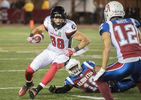 Ottawa Redblacks' Brad Sinopoli cuts through the Montreal Alouettes defence during Friday's game. (THE CANADIAN PRESS)