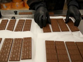 A worker prepares to package freshly made marijuana infused chocolate bars on January 16, 2018 in Oakland, California. (Justin Sullivan/Getty Images)