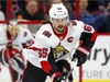FILE - In this Jan. 30, 2018, file photo, Ottawa Senators' Erik Karlsson (65) moves the puck against the Carolina Hurricanes during the first period of an NHL hockey game, in Raleigh, N.C. A jump in the salary cap should make for a more entertaining NHL offseason. Karlsson and Islanders center John Tavares could be among the high-end players on the move in the coming weeks. (AP Photo/Karl B DeBlaker, File) ORG XMIT: NY164