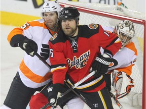 Forward Brian McGrattan, middle, and goalie Ray Emery, right, were good friends during their time together with the Ottawa Senators. McGrattan mourned Emery on Twitter on Sunday. Jim Wells/Postmedia