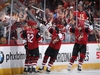 Richard Panik (14), Jordan Oesterle (82), Clayton Keller (9) and Alex Galchenyuk (17) of the Coyotes celebrate after Panik scored a goal against the Senators during the second period of Tuesday's game. Christian Petersen/Getty Images