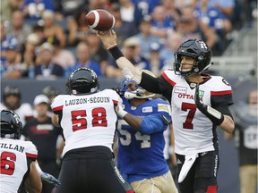 Redblacks quarterback Trevor Harris throws a pass in the Aug. 17 game against the Blue Bombers in Winnipeg.