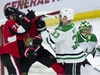 Dallas Stars defenceman Marc Methot clears Ottawa Senators left wing Magnus Paajarvi and centre Chris Tierney from in front of goaltender Ben Bishop during first period NHL action Monday October 15, 2018 in Ottawa. THE CANADIAN PRESS/Adrian Wyld ORG XMIT: ajw102