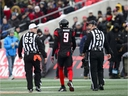 Ottawa Redblacks' Jonathan Rose (9) is escorted off the field while taking on the Hamilton Tiger-Cats during first half CFL East Division final action on Sunday, Nov. 18, 2018.