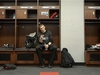 Ottawa Redblacks quarterback Trevor Harris checks his phone after participating in a media interview as the team clears out of the locker room, in Ottawa on Tuesday, Nov. 27, 2018. THE CANADIAN PRESS/Justin Tang ORG XMIT: JDT102