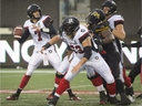 Redblacks quarterback Trevor Harris prepares to throw a pass in an Oct. 27 game against the Ticats in Hamilton.