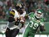 Hamilton Tiger-Cats quarterback Jeremiah Masoli, left, is chased by Saskatchewan Roughriders defensive lineman Charleston Hughes during second half CFL action at Mosaic Stadium in Regina on Thursday, July 5, 2018. The Saskatchewan Roughriders will face the Calgary Stampeders on Saturday without CFL sack leader Charleston Hughes after all. THE CANADIAN PRESS/Mark Taylor ORG XMIT: CPT133