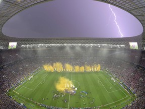 Lightning strikes as France players celebrate after the Russia 2018 World Cup final football match between France and Croatia at the Luzhniki Stadium in Moscow on July 15, 2018.