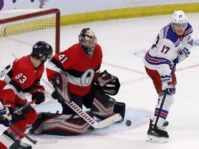 Ottawa Senators goaltender Craig Anderson (41) keeps his eye on the puck as the New York Rangers' Jesper Fast (17) attempts to deflect the puck during the second period on Thursday, Nov. 29, 2018.