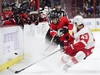Ottawa Senators defenceman Chris Wideman (6) blasts the puck past Detroit Red Wings left wing Darren Helm (43) during second period NHL hockey action in Ottawa on Thursday, Nov. 15, 2018. THE CANADIAN PRESS/Sean Kilpatrick ORG XMIT: SKP112