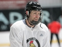 Senators forward Zack Smith wears a full cage for practice on Tuesday and will do so again when he rejoins the NHL team's lineup for Thursday's home game against the Red Wings.. Wayne Cuddington/Postmedia