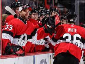 Colin White #36 of the Ottawa Senators celebrates his second period power-play goal against the Montreal Canadiens with teammate Mike McKenna #33 on Thursday.