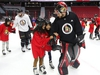 Mike McKenna holds up kids from St. Michael Catholic School and D. Roy Kennedy Public School during the 15th annual Eugene Melnyk Skate for Kids at Canadian Tire Centre, December 20, 2018.    Photo by Jean Levac/Postmedia News  130657