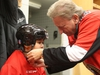 Eugene Melnyk ties the helmet of Eh Nay Soe Kyu of D Roy Kennedy school during the 15th annual Eugene Melnyk Skate for Kids at Canadian Tire Centre, December 20, 2018.    Photo by Jean Levac/Postmedia News  130657