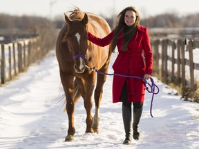 Emily Bertrand walks with her horse Fred at the Royale Equestrian Centre.