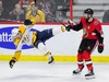 Ottawa Senators left wing Zack Smith (15) sends Nashville Predators right wing Ryan Hartman (38) for a tumble during third period NHL hockey action in Ottawa on Monday, Dec. 17, 2018. THE CANADIAN PRESS/Sean Kilpatrick ORG XMIT: SKP112