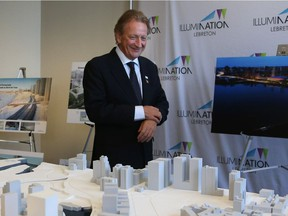 Eugene Melnyk walks in front of his winning proposal of the Lebreton Flats redevelopment in Ottawa, April 28, 2016.