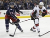 Ottawa Senators' Cody Ceci, right, backhands a shot as Columbus Blue Jackets' Ryan Murray defends during the third period of an NHL hockey game Monday, Dec. 31, 2018, in Columbus, Ohio. (AP Photo/Jay LaPrete) ORG XMIT: OHJL113